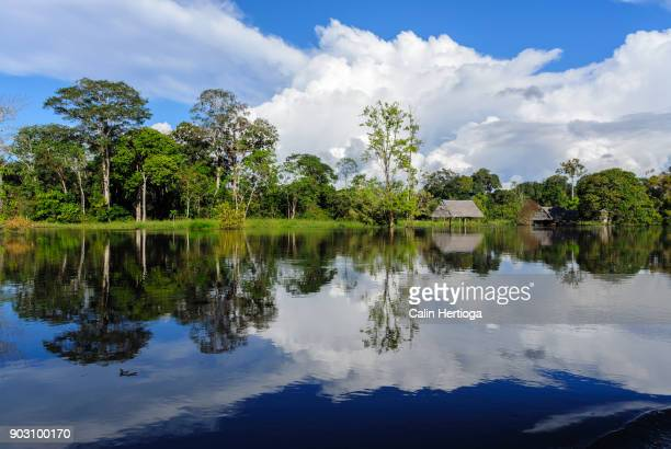 Clouds and blue sky reflected in the Amazon river