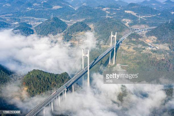 Clouds and fog drift over the Gongshui River Bridge on November 15, 2020 in Xuan en County, Hubei Province of China.