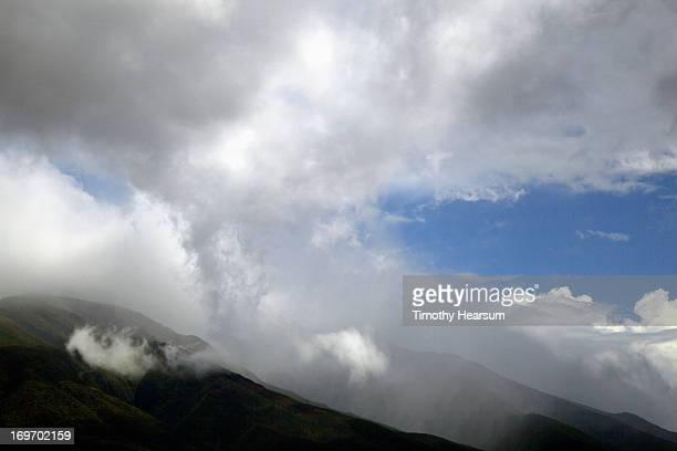clouds and mist rise up from mountains - timothy hearsum stock pictures, royalty-free photos & images