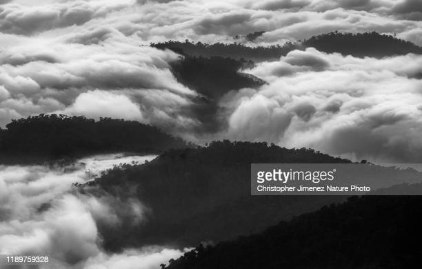 clouds and mountains in black and white - christopher jimenez nature photo stock pictures, royalty-free photos & images