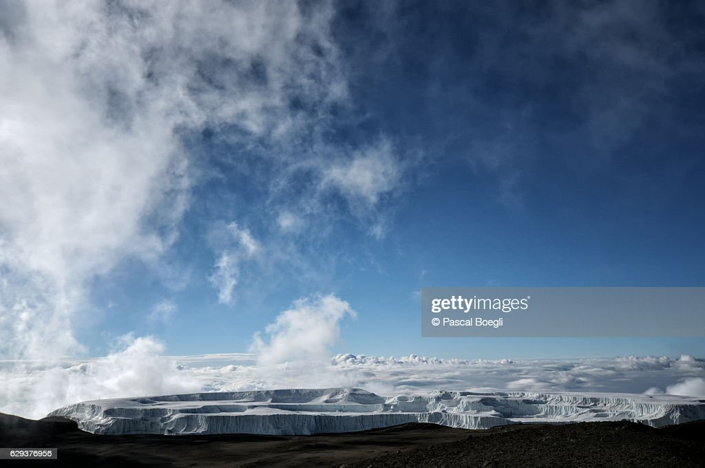 Clouds and Northern Icefield near the summit, Kilimanjaro National Park : Stock Photo