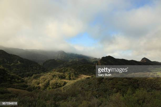 clouds and ocean air over mountain range and valley - calabasas stock photos and pictures
