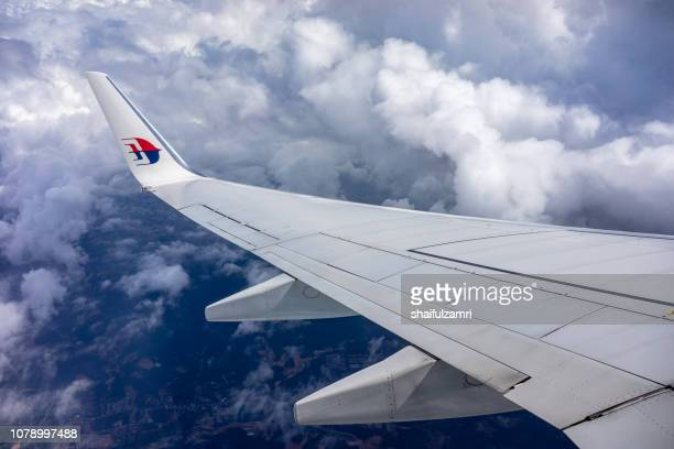 clouds and sky as seen through window of an malaysian airlines's aircraft. - shaifulzamri - fotografias e filmes do acervo