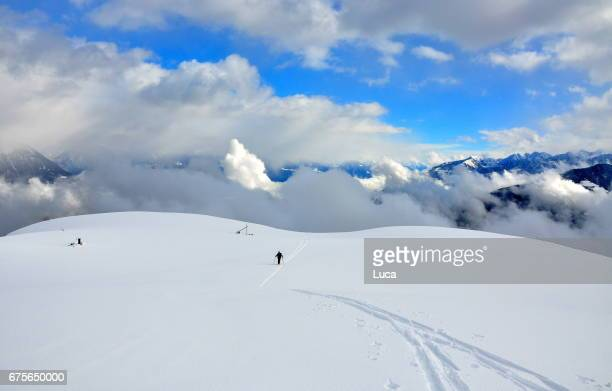 clouds and snow - snowfield stock pictures, royalty-free photos & images