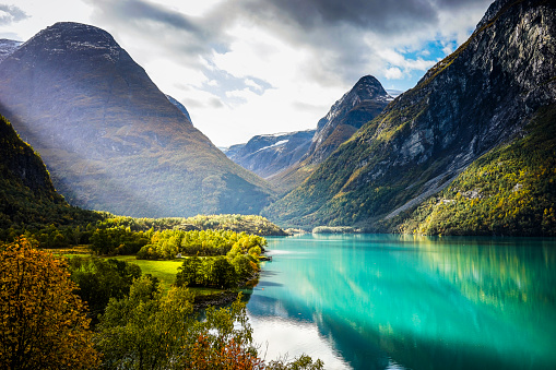 Clouds and sun beams over fjord - gettyimageskorea