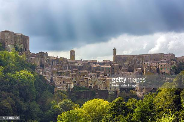 Clouds and sunrays above Sorano