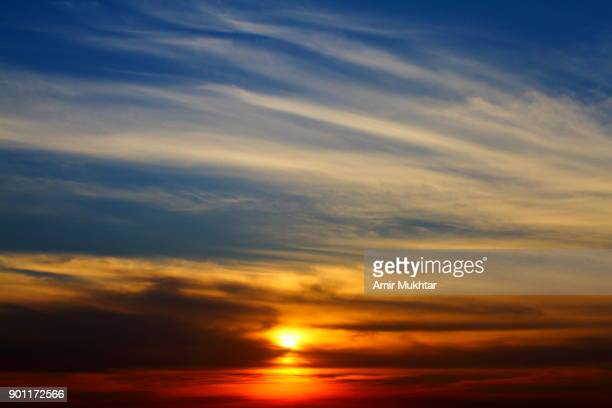clouds and the sunset - amir mukhtar stock photos and pictures
