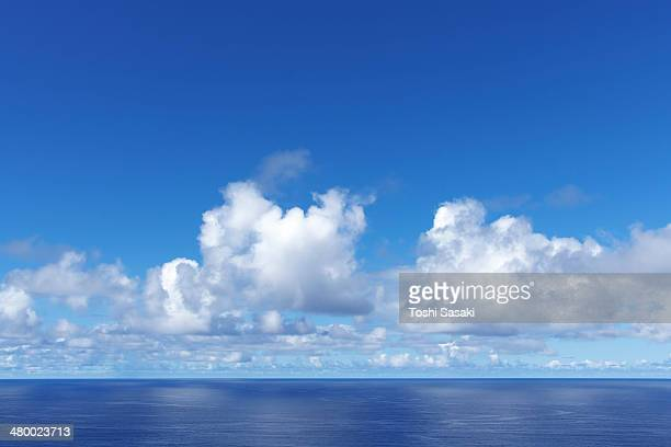 Clouds appearing above the blue ocean