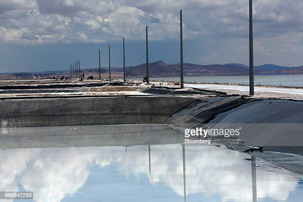 Clouds are reflected in an evaporation pool where lithium bicarbonate is isolated from salt brine during the process of lithium production at the...