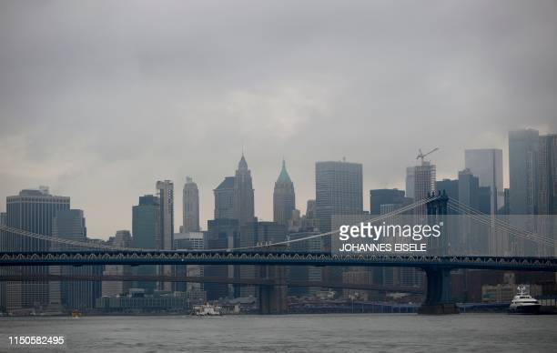Clouds are seen above the Brooklyn Bridge and lower Manhattan on June 18 2019 in New York City
