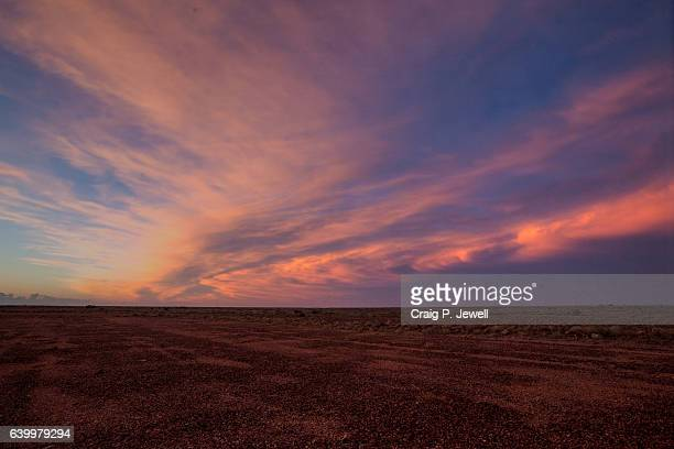 clouds at dusk over the australian outback - horizon stock pictures, royalty-free photos & images