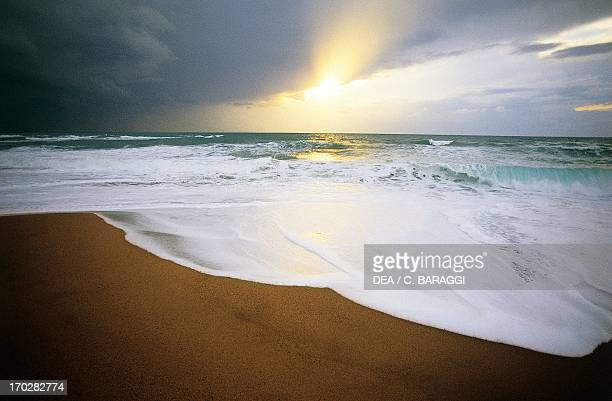 Clouds at sunset on the beach of Cirella on the Tyrrhenian coast Calabria region Italy