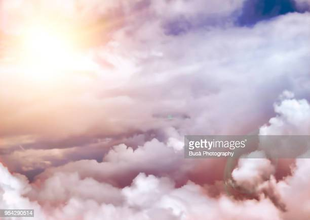 clouds at sunset, view from aircraft - deus imagens e fotografias de stock
