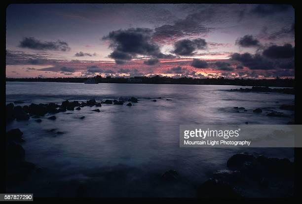 Clouds cover the sky above Puerto Ayora at sunset Santa Cruz Island Galapagos Islands Ecuador
