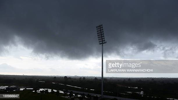 Clouds darken the sky after rain showers delayed the start of play on the fourth One Day International match between Sri Lanka and New Zealand at The...