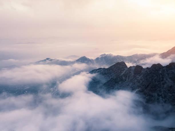 Clouds Drift Amid Rocky Cliffs - Fine Art prints