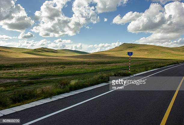 Clouds float above a highway on Hulunbuir Grasslands,Hulun Buir City,Inner Mongolia,China