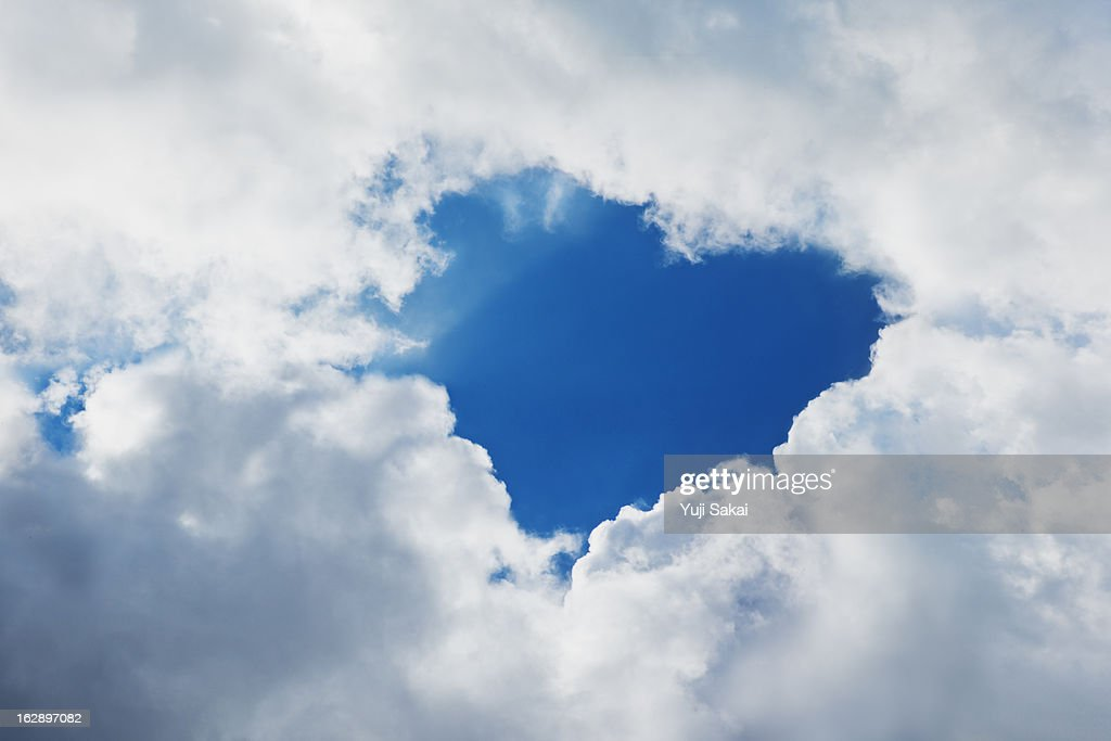 clouds forming heart in sky : Stock Photo
