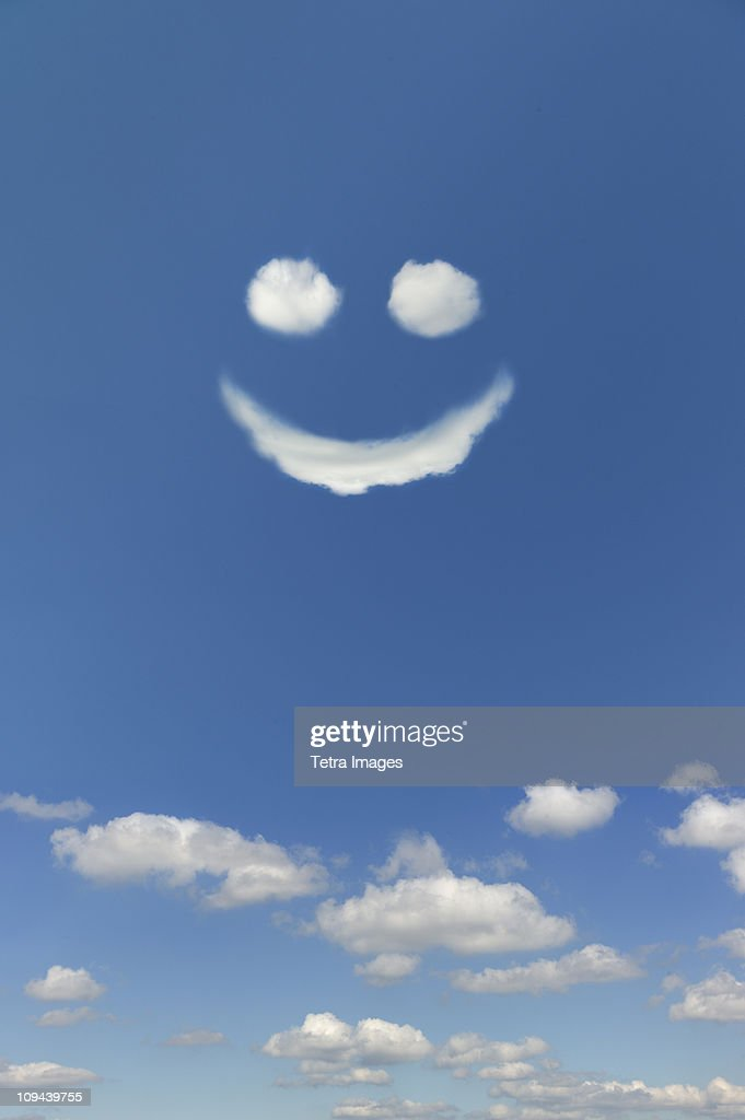 Clouds forming smiley face in sky : Stock Photo