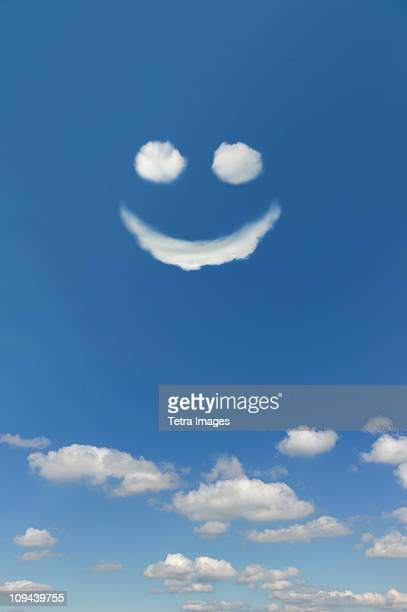 clouds forming smiley face in sky - smiley face stock pictures, royalty-free photos & images