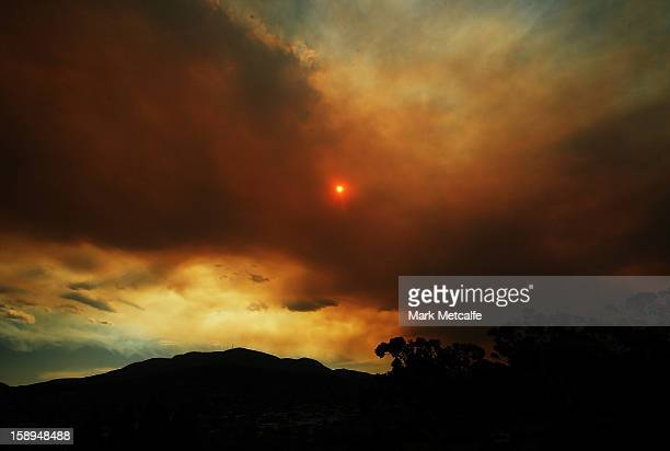 Clouds from a nearby bushfire are seen over Mount Wellington during day one of the Hobart International at Domain Tennis Centre on January 4 2013 in...