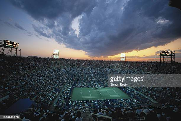 Clouds gather as the sun sets at dusk over the center court at the U.S.Open Tennis Championship on 7th September 1993 at the USTA National Tennis...