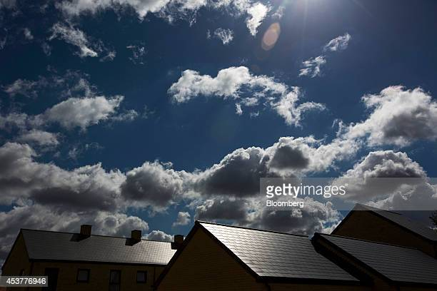 Clouds gather in the summer sky above newly constructed houses at the St Andrew's Park residential construction site operated by Persimmon Plc in the...