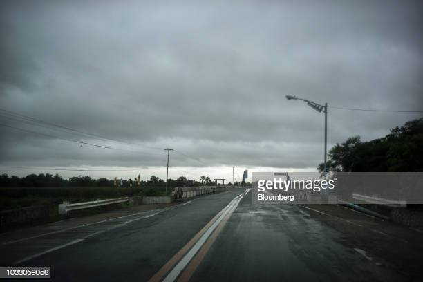 Clouds gather over a highway leading to Tuguegarao ahead of Typhoon Mangkhut's arrival in Cagayan province the Philippines on Friday Sept 14 2018...