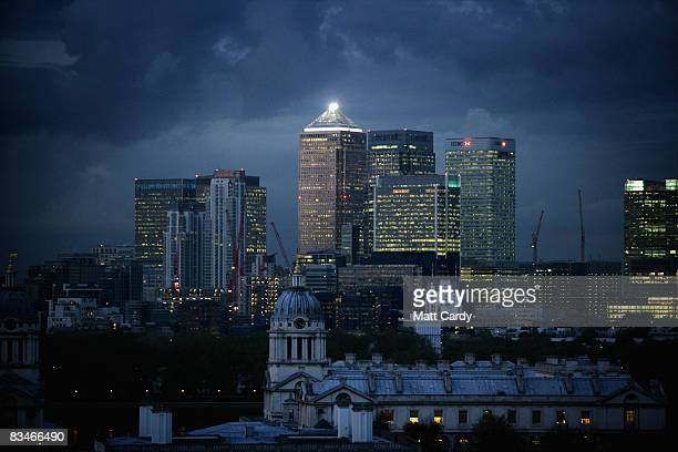 Clouds gather over high-rise buildings in the financial district of the Canary Wharf area of East London as workers remain in their offices as the...