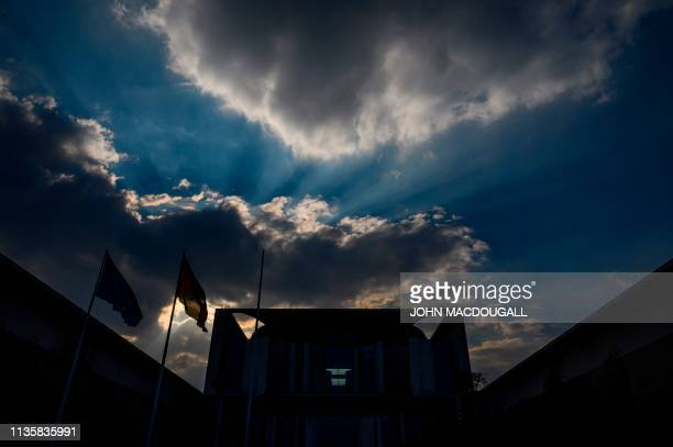 TOPSHOT Clouds gather over the chancellery building in Berlin on April 8 2019