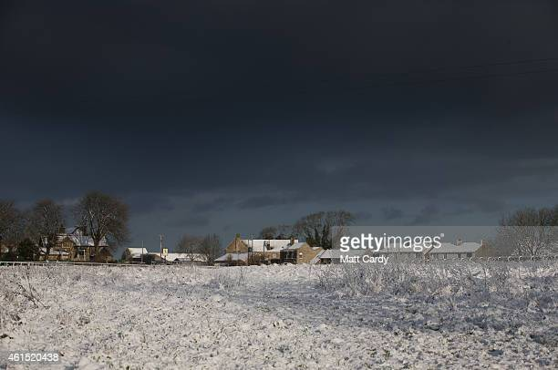 Clouds gather over the snow that has fallen overnight on the Bath Racecourse on January 14 2015 in Bath England Snow has fallen in some parts of the...