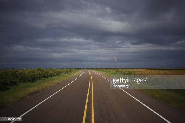 Clouds gather over the state highway 87 ahead of Hurricane Laura in Sabine Pass, Texas, U.S., on Tuesday, Aug. 25, 2020. Hurricane Laura is poised to...