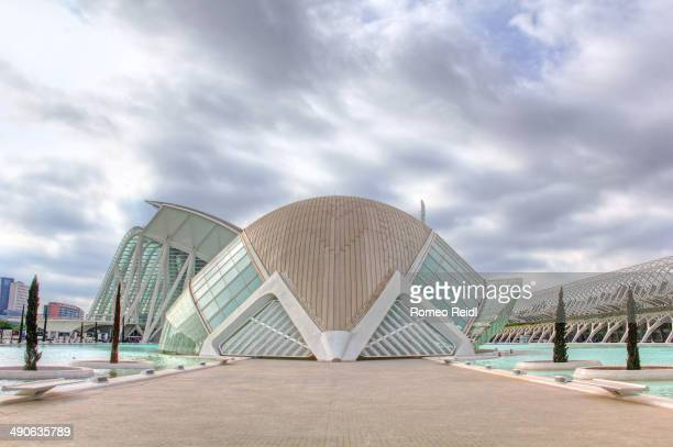 Clouds gathering over the L'Hemisfèric - an IMAX Cinema, planetarium and laserium inside the City of Arts and Sciences in Valencia, Spain. HDR image.