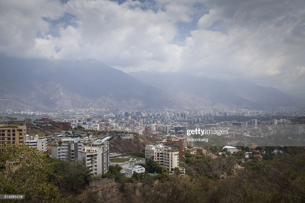 Clouds hang above Avila Mountain as seen from the offices of Knossos Asset Management in Caracas, Venezuela, on Wednesday, March 2, 2016. When managing directors Carmelo Haddad and Francisco Ghersi nvested half their hedge fund's money into a soon-to-mature Venezuela bond in mid-January, only two outcomes were possible: the trade could go horribly wrong or it could pay off fabulously. Knossos Asset Management went on to make a return of 12 percent in just 45 days -- or an excess of 150 percent on an annualized basis. Photographer: Wilfredo Riera/Bloomberg via Getty Images