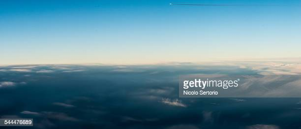Clouds, horizon and plane from the air