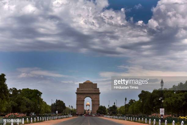Clouds hover over the blue sky at India Gate during the lockdown to limit the coronavirus on April 20 2020 in New Delhi India With vehicles off the...
