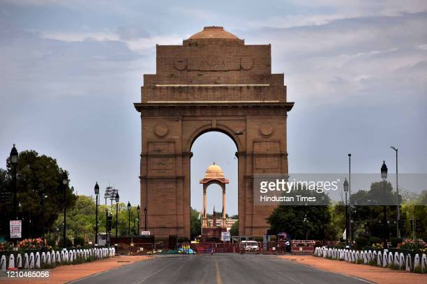 Clouds hover over the sky at India Gate during the lockdown to limit the coronavirus on April 20, 2020 in New Delhi, India. With vehicles off the...
