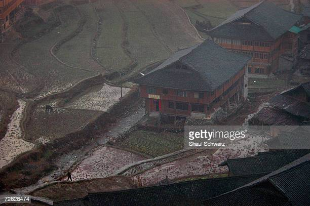 Clouds hover over traditional houses on February 11 2004 in the Longsheng area in the south of China 90 kilometers north of Guiln lays a popular...