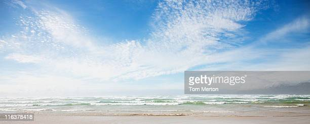 clouds in blue sky over ocean - panoramic stock pictures, royalty-free photos & images