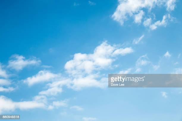 clouds in blue sky - himmel stock-fotos und bilder