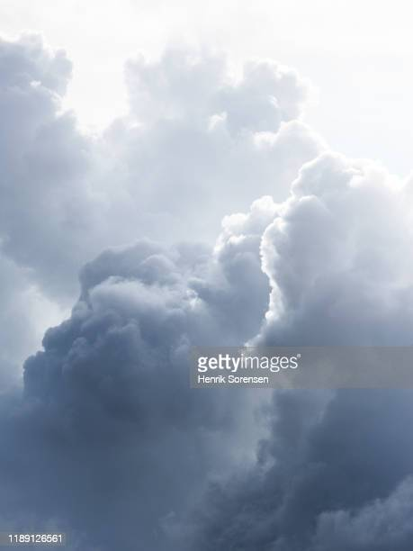 clouds in the sky - moody sky stock pictures, royalty-free photos & images