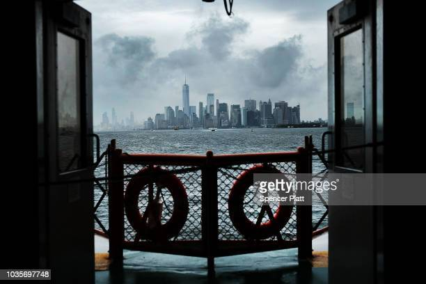 Clouds linger over the Statue of Liberty as what remains of Hurricane Florence moves through the area on September 18 2018 in New York City New York...