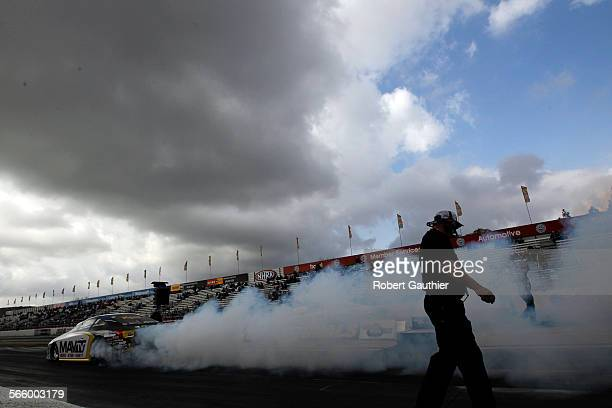 Clouds loom over and on the track during a blustery day at the NHRA Winternationals at Pomona Raceway