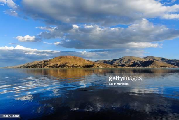 Clouds mirrored in clear lake Titicaca