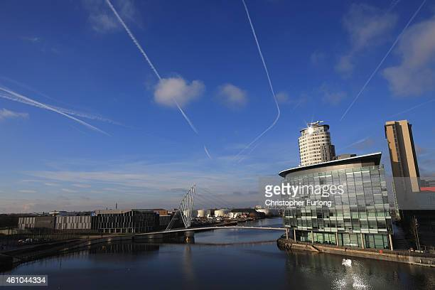Clouds move about the Media City in Salford Quays which is home to the BBC ITV television studios and also houses many media production companies on...