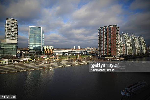 Clouds move above the Media City in Salford Quays which is home to the BBC ITV television studios and also houses many media production companies on...