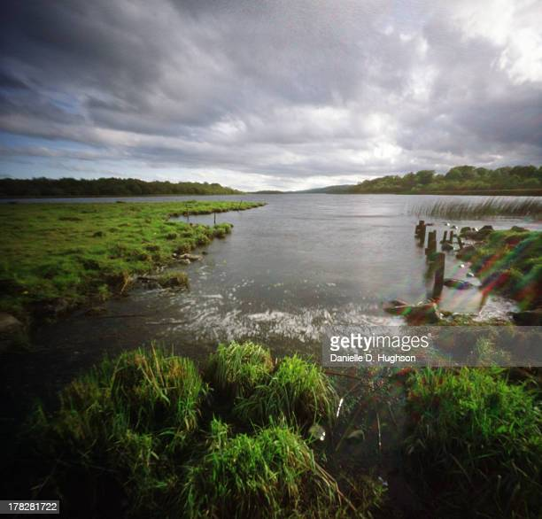 clouds moving above an irish lough - county fermanagh stock photos and pictures
