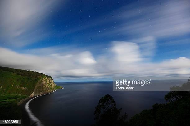 Clouds moving above Waipio Valley at moon night