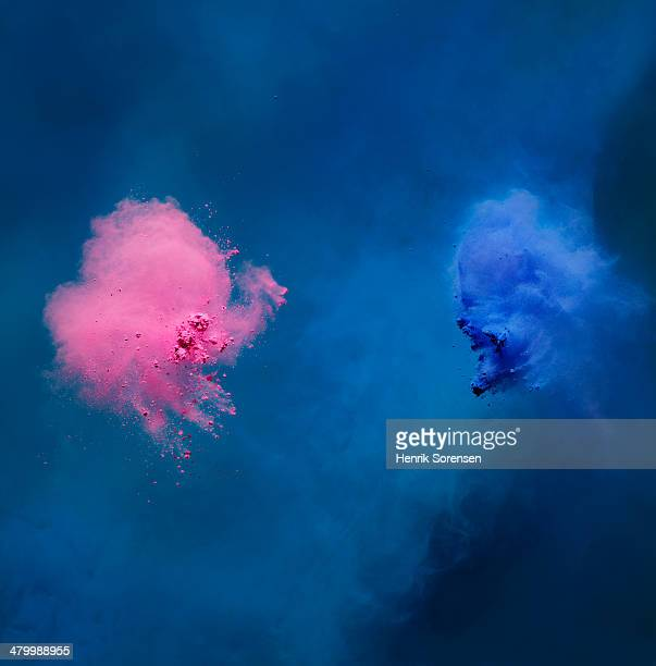 2 clouds of colored powder