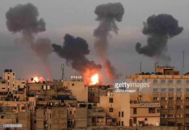 Clouds of dark smoke seen over Gaza City after an Israeli air strike. Explosions and fire caused by Israeli air strikes in the southern Gaza Strip,...